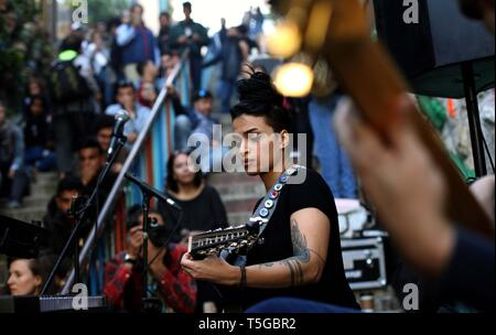 Amman, Jordan. 24th Apr, 2019. Bal Qeis, an Egyptian singer and oud player, performs at a free street concert near Shamasi stairs, downtown Amman, Jordan, on April 24, 2019. The 8th Amman Jazz Festival is held here between April 19 and 25. Credit: Mohammad Abu Ghosh/Xinhua/Alamy Live News - Stock Image