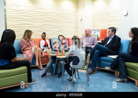 U.S. First Lady Melania Trump chats with young patients and their families during the traditional holiday visit to Childrens National Hospital December 13, 2018 in Washington, DC. - Stock Image
