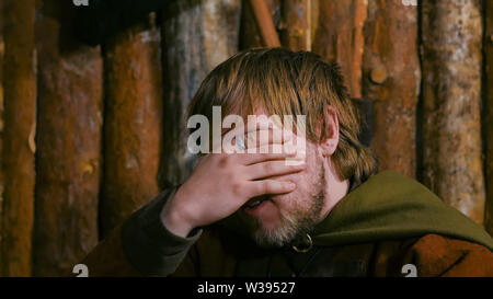 Portrait of sad man in russian ethnic suit - Stock Image