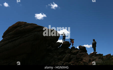 Hiker with clouds on Pikes Peak National Park ridge Colorado Rocky Mountain - Stock Image