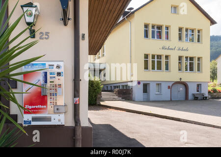 Cigarette vending machine next to a primary school, Oberried, Germany, Europe - Stock Image