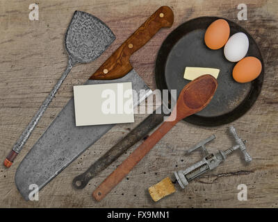 vintage set for frying eggs over wooden table, space on business card for your text - Stock Image