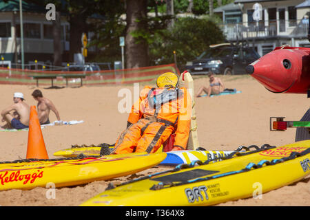 Surf rescue training area on Palm beach in Sydney with dummy manikin to practice rescues on and yellow surfboards,Sydney,Australia - Stock Image