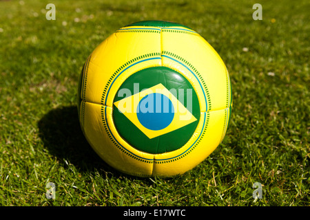 Brazilian football on grass for for Brazil World Cup 2014. - Stock Image