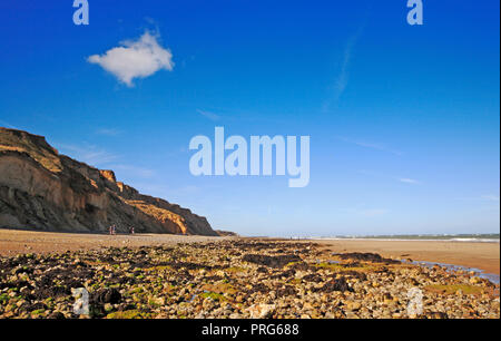A view westwards along the North Norfolk beach at East Runton, Norfolk, England, United Kingdom, Europe. - Stock Image