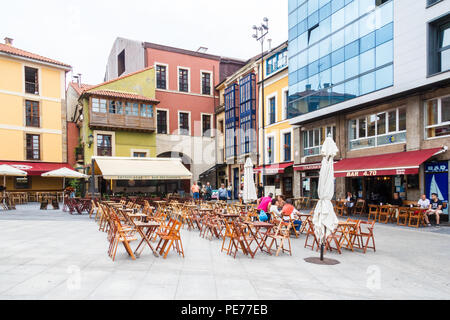 Gijon, Spain - 6th July 2018: Typical square with bars. Al fresco eating and drinking is popular all over Spain. - Stock Image