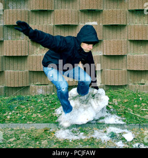 young man,jump,snow - Stock Image