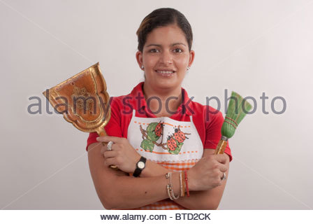 Beautiful maid is ready to work. - Stock Image