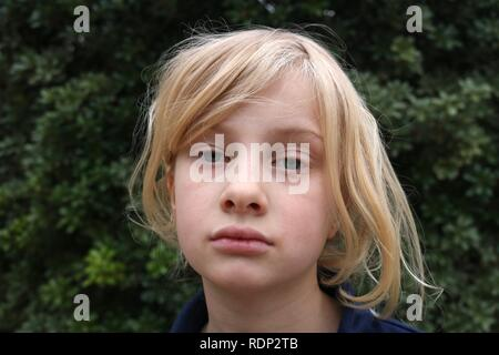 Close up of face of a pale unhappy listless young blonde girl - Stock Image