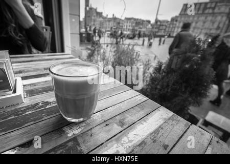 Coffee on a table in a coffe shop window. - Stock Image