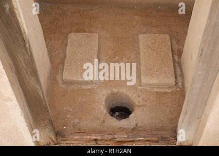 Hole in the floor, squat toilet, Al Alawi House, located on the Pearl Trail, Muharraq, Kingdom of Bahrain - Stock Image