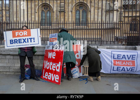Brexiteers protest with home-made placards outside Parliament,  on 11th March 2019, in Westminster, London, England. - Stock Image