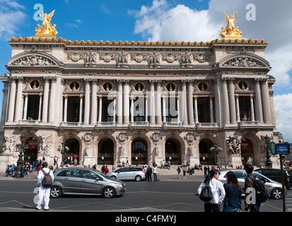 Tourists visit the Opera Garnier, a grand landmark in Paris, France. - Stock Image