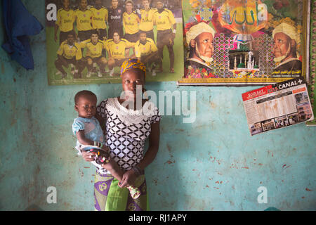Baribsi village, Yako province, Burkina Faso; A teenage mothger with her young child at her parents house. - Stock Image