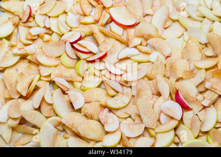 Fresh sliced apple cooked for drying - Stock Image