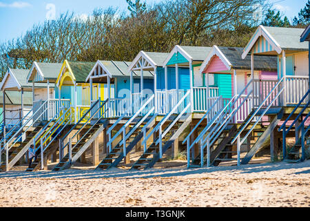 Colourful beach huts on Wells beach at Wells next the Sea on North Norfolk coast, East Anglia, England, UK. - Stock Image