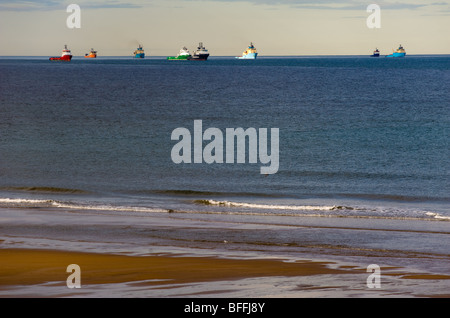 photograph of supply boats queing for work in the north sea - Stock Image