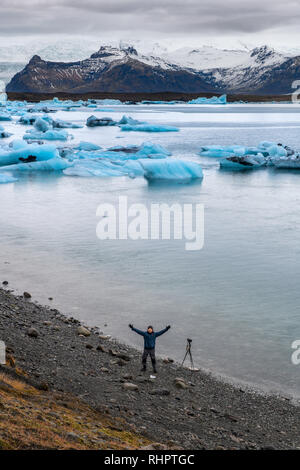 The glacier lagoon Jokulsarlon, located in Southeast Iceland is filled with icebergs. This ice lagoon has become one of Iceland's most popular attract - Stock Image