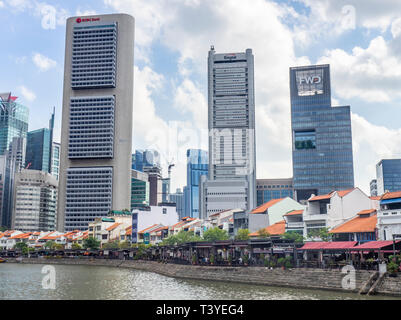 Restaurants lining Boat Quay on the Singapore River running through the Central Business District CBD of Singapore. - Stock Image