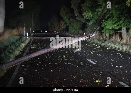 Krajkova, Czech Republic. 21st Sep, 2018. A fallen power line on a road after a storm with strong wind near Kajkova Village, Karlovy Vary Region, Czech Republic, on September 21, 2018. Credit: Slavomir Kubes/CTK Photo/Alamy Live News - Stock Image