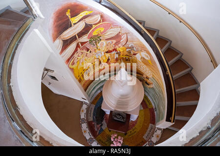 A staircase, mural and statuel at the New York Buddhist Vihara Association in Parkside Hills, Queens, New York City. - Stock Image