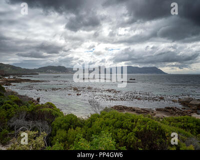 Simon's Town seen across False Bay on the South Atlantic coast of the Western Cape near Cape Town, South Africa - Stock Image
