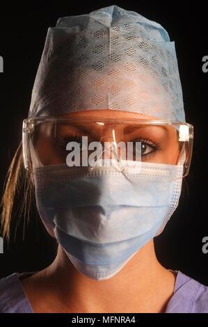 Nurse with mask   Ref: CRB425_10046_089  Compulsory Credit: Synercomm/Photoshot - Stock Image