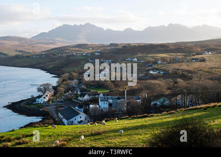 View looking over Carbost on Loch Harport to distant Cuillin Hills, Isle of Skye, Highland Region, Scotland, UK - Stock Image