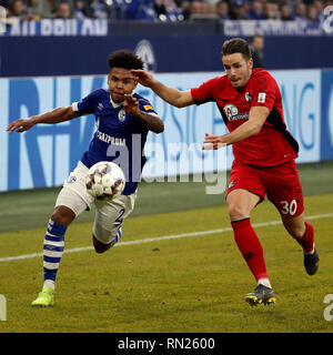 Gelsenkirchen, Germany. 16th Feb, 2019. Christian Guenter (R) of Freiburg vies with Weston McKennie of Schalke 04 during the Bundesliga match between FC Schalke 04 and SC Freiburg in Gelsenkirchen, Germany, Feb. 16, 2019. The match ended in a 0-0 draw. Credit: Joachim Bywaletz/Xinhua/Alamy Live News - Stock Image