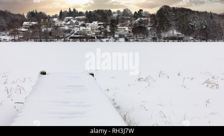 Winter landscape view of frozen and snow covered lake Sävenlången in Floda, Sweden - Stock Image