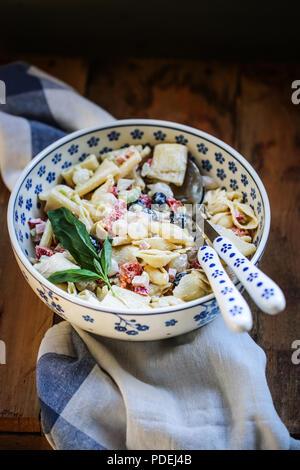 Bowl of fresh pasta salad. - Stock Image