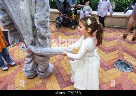 Miami Florida Adrienne Arsht Performing Arts Center centre Family Fest girl child mascot costume pull tail play mischief - Stock Image