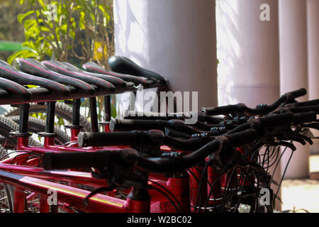 Many red colored new giant brand bicycles for sale outside the shop in New Delhi India - Stock Image