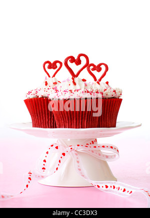 Cupcakes with vanilla frosting for Valentine's day. - Stock Image