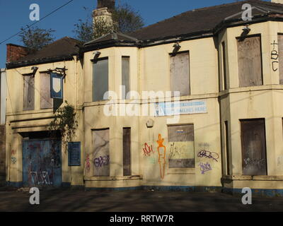 Plants growing out of a closed down, semi derelict former pub (The Burgoyne Arms) in Sheffield, UK. Shut pub - Stock Image