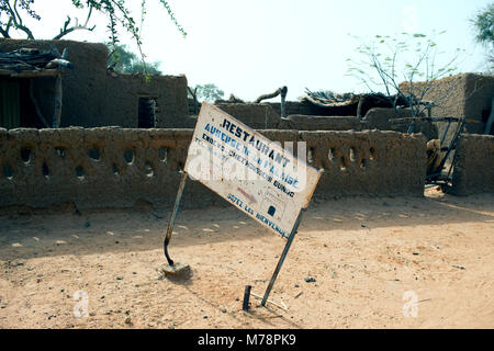 A restaurant sign in a Dogon country village does not look too inviting. Mali, West Africa. - Stock Image