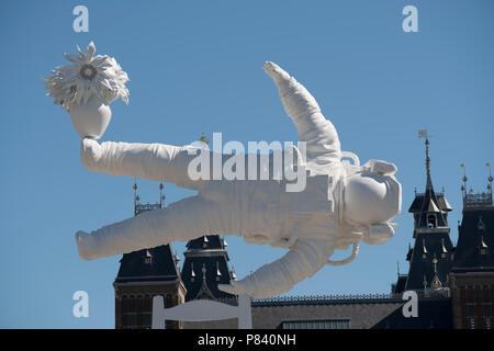 Astronaut art on the museum square in Amsterdam by Joseph Klibansky - Stock Image
