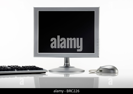 Silver LCD monitor with mouse and keyboard - Stock Image