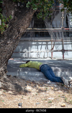 Man Sleeping on Cape Town City Street - South Africa - Stock Image