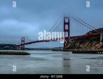 Panoramic view of the western span of the Golden Gate Bridge on a foggy winter morning viewed from Fort Baker site - Stock Image