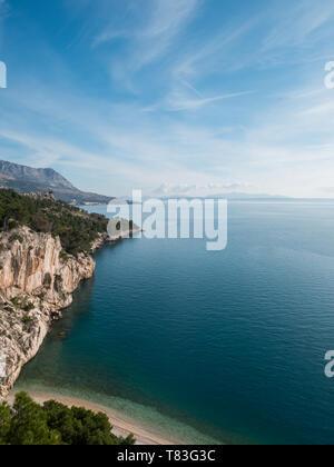 Empty hidden paradise beach and calm blue sea on sunny summer day in Croatia - Stock Image