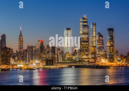 The mixed-use Hudson Yards real estate development and other buildings on the West Side of Manhattan in New York City at dawn. - Stock Image