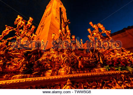 A paso (float) of the crucifixion of Jesus Christ in the procession of the Brotherhood (Hermandad) San Benito, Holy Week (Semana Santa), Seville, Anda - Stock Image