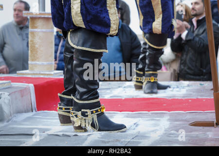 Black Boots of men in the band - Real Imperariz playing D'Artagnan and the three muskateers.  Mealhada Carnaval parade, Portugal - Stock Image