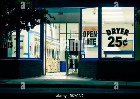 Night view of a laundromat facade in Ramona in California. - Stock Image