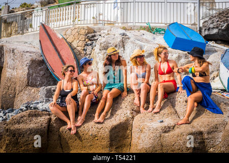 group of nice and beautiful friends smiling together having fun in friendship summer leisure time outdoor near the beach. squimsuits and ladies enjoye - Stock Image