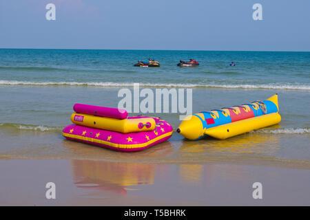 Inflatable floats, beach, Hua Hin, Thailand - Stock Image