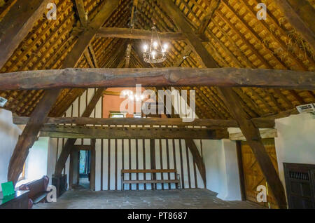 Interior of the late  16th century Manor house showing the cruck built roof at the Ryedale Folk Museum in Hutton le Hole North Yorkshire England UK - Stock Image