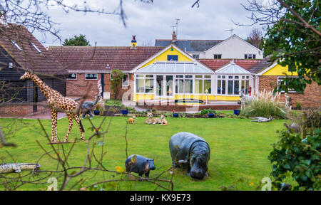 Menagerie of animal figures in a private garden, Heybridge BasinMaldon, Essex, England, UK - Stock Image