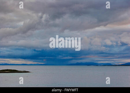 Stormy clouds are towering over the North Atlantic seen from island Senja in northern Norway. - Stock Image